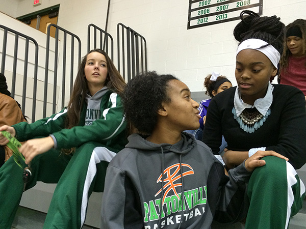 Photo: Pattonville High School basketball players (left to right) Cassie Callahan, Allyson Sanders, and Tyra Brown watch the B-squad before a home game in Maryland Heights, Missouri. Photo by John Biewen.