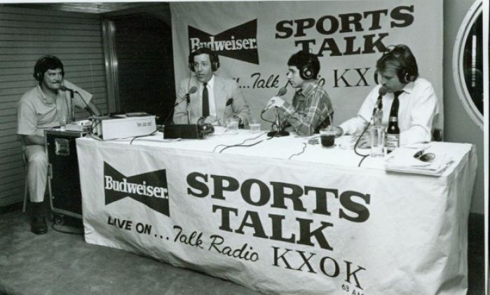 Photo: Radio talk-show hosts Jon Sloane (second from left) and Mark Eissman (second from right), during a KXOK broadcast in the late 1980s. Photographer unknown.